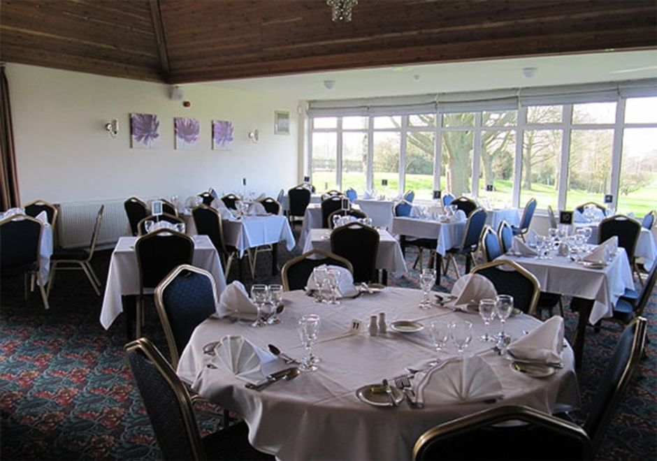 Lutterworth Golf Club Function Room, set out for a celebration meal, overlooking the course